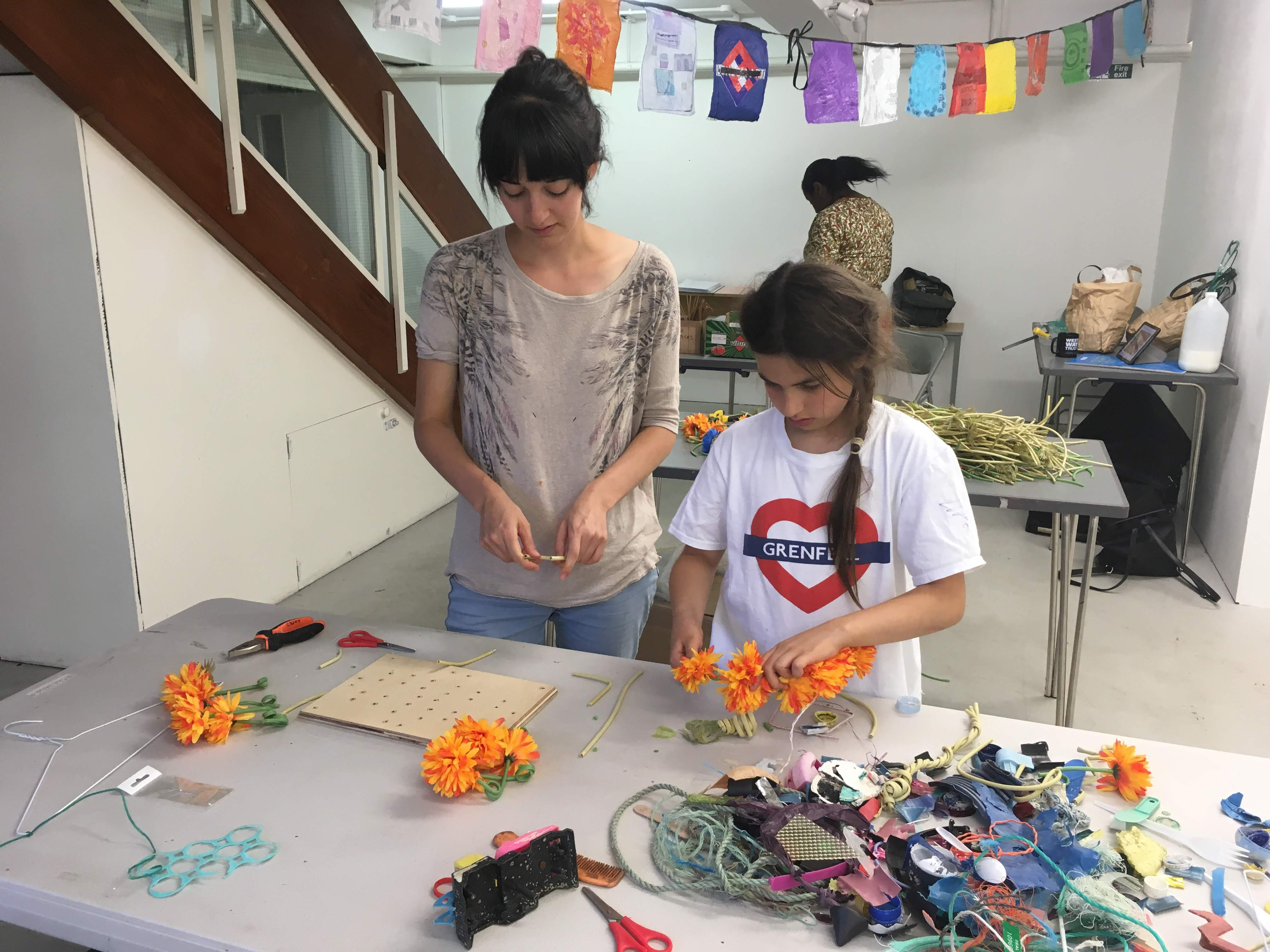 Families creating hanging sculptures from discarded plastics.